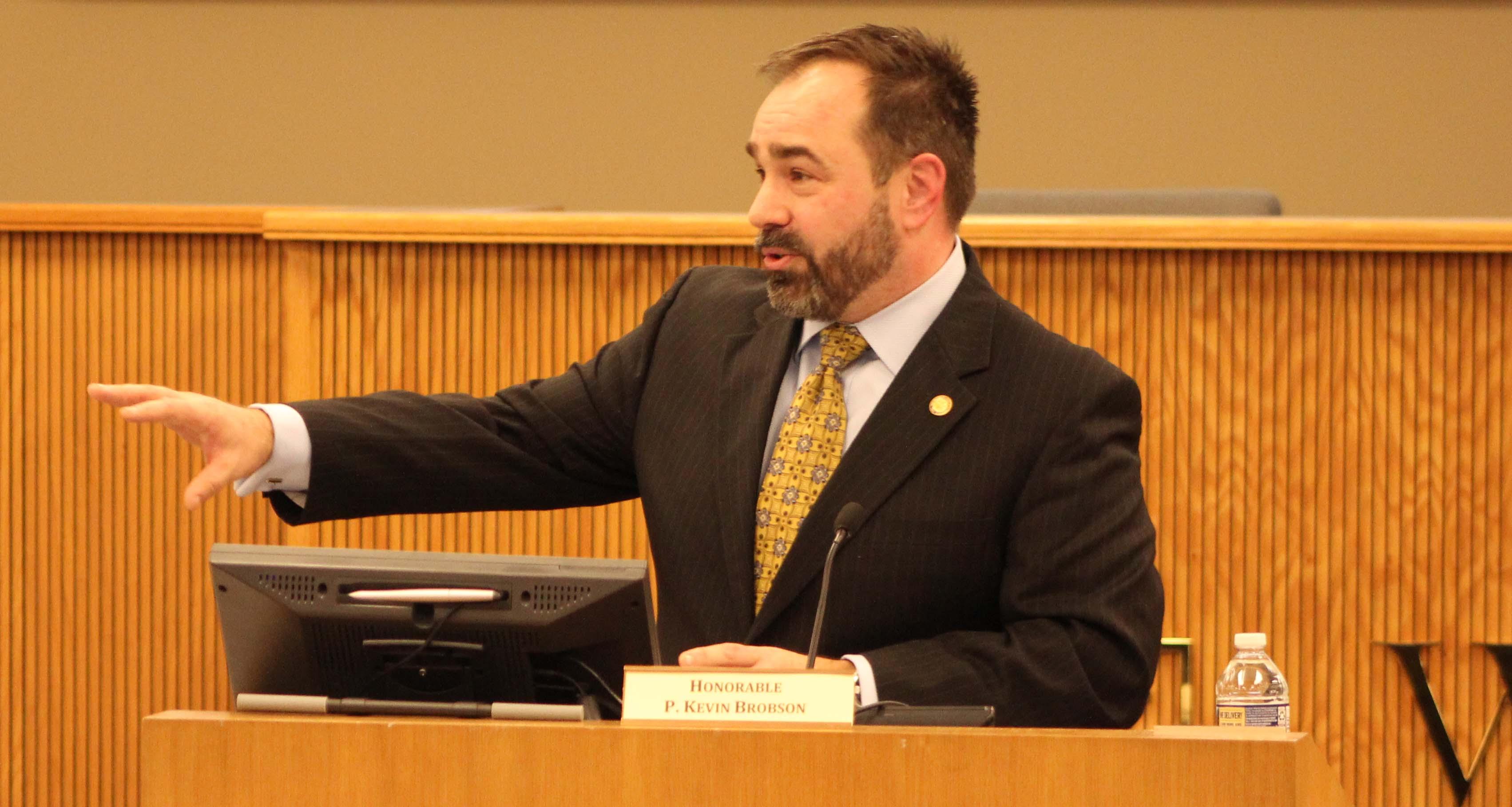 Judge Kevin Brobson speaks at podium.