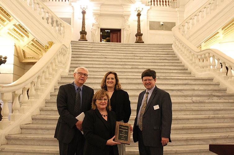 Photo of Irene, Adjunct Professor Schuckers, Professor Family, and Dean Johnson
