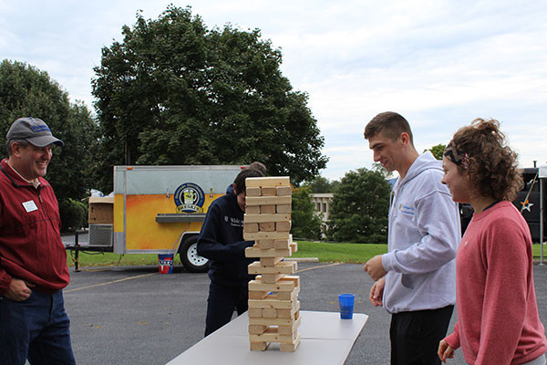 students playing jenga at Dean's picnic